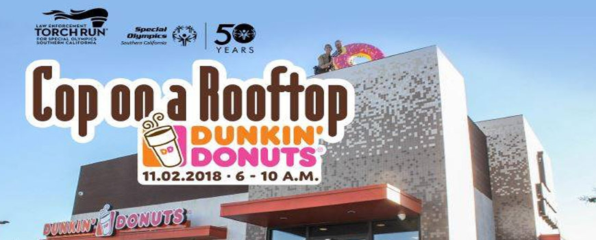 Cop On A Roof Top In Support Of Special Olympics